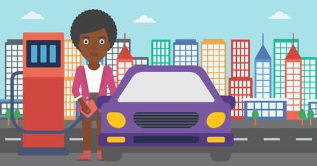 Woman filling up fuel into car.