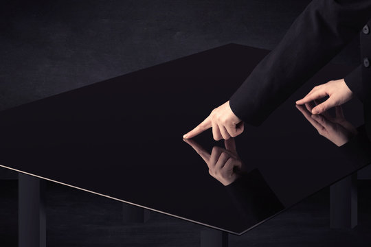 Close up of a hand touching smart table with copy space