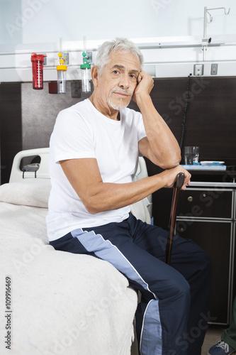 5ce071fa58a Sad Senior Man Holding Cane At Rehab Center