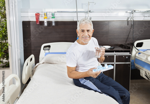 b449e7ab5f5 Patient Holding Pill Organizer And Water Glass In Rehab Center ...