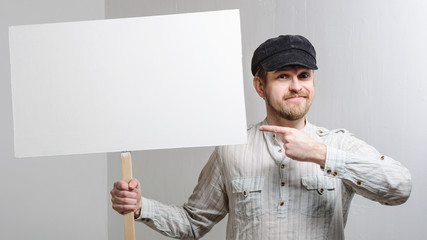 Angry protesting worker with blank protest sign
