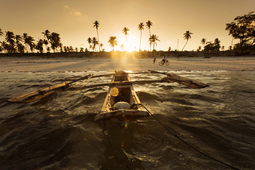 Printed kitchen splashbacks Zanzibar Traditional fishing boat floating on ocean at beautiful sunset i