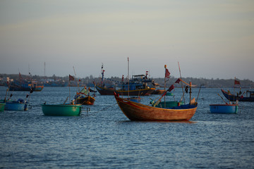 fishing boats in vietnam at sunset