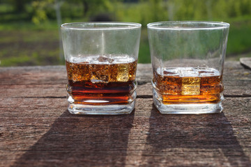 Two glasses of cola with ice