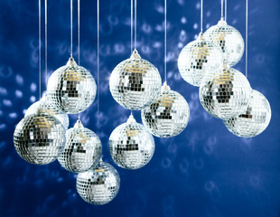 Mirrored disco balls with light spots over background