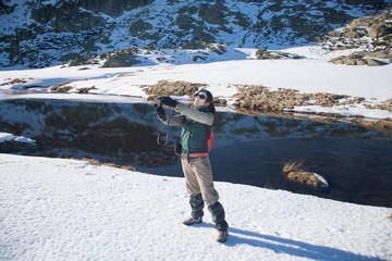 trekking woman photographing selfie