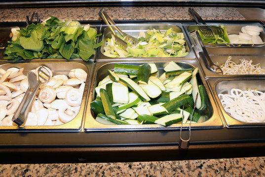 mix of raw vegetables with mushrooms and zucchini in the school