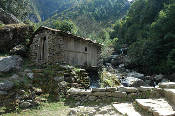A Stone & Wood Cabin Above The Melting Waters Of The Himalayas