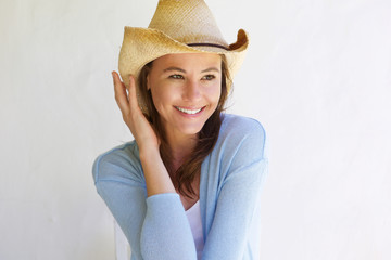 Beautiful young woman with hat smiling