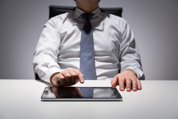 Businessperson using tablet