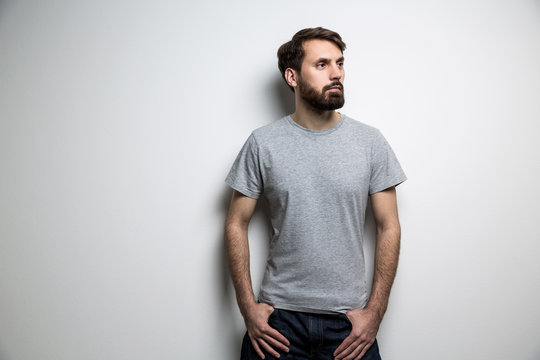 Man with beard grey t-shirt