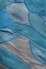 Blue patchwork background of genuine leather