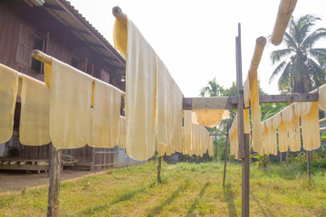 Rubber sheet hung on a rack to dry.