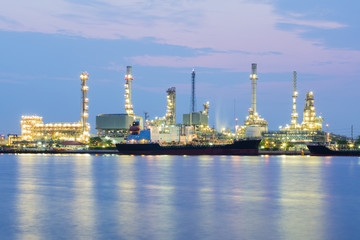 Oil refinery river front, heavy industry with beauty sky background before sunrise