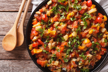 Spanish cuisine: vegetable stew Pisto manchego close-up. Horizontal top view