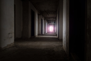 Abandoned building / View of inside the abandoned building, Halloween background. Dark tone with violet light.