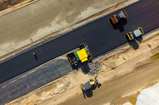 Road rollers working on the construction site aerial view