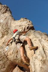 Rock climber on artificial cliff