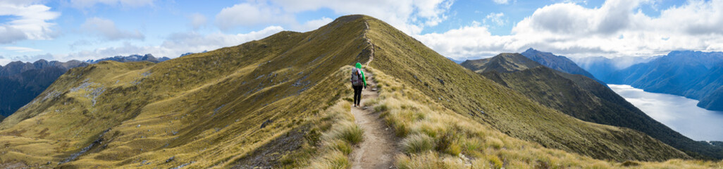 Woman hiker walking on an alpine section of the Kepler Track