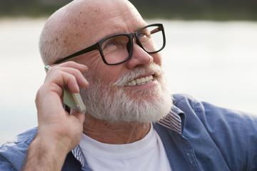 older man using a smartphone