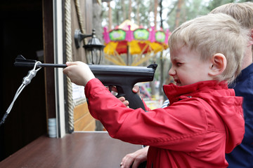 Boy shooting air pistol