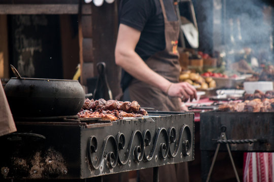 barbeсue grill, skewers with meat, brazier, cauldron, chef