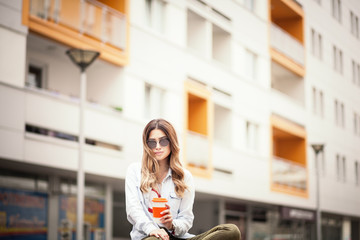 Fashion young women with a cup of coffee