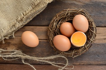 Brown eggs on wooden table with sacking background