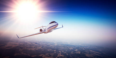 Realistic image of White Luxury generic design private jet flying over the mountains. Empty blue sky with sun at background. Business Travel Concept. Horizontal. 3d rendering