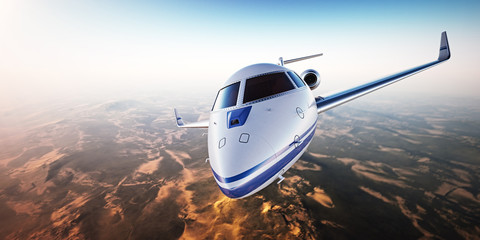 Closeup. Realistic image of White Luxury generic design private jet flying over the mountains. Empty blue sky with sun at background. Business Travel Concept. Horizontal. 3d rendering