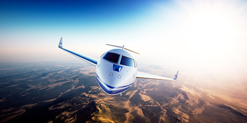 Realistic photo of White generic design private jet flying over the mountains.Empty blue sky and sun at background.Business Travel by modern Luxury aircraft.Horizontal,front view closeup. 3d rendering