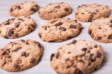 close up of chocolate chip cookies on wooden table