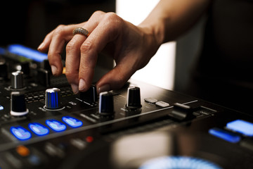 Close-up of hands in a mixer