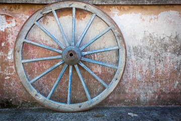 Old ironed, blue wagon or carriage wheel