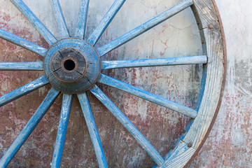 Part of old ironed blue wagon or carriage wheel