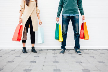 Woman and man holding shopping bags