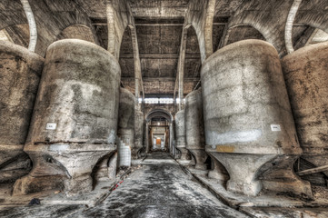 Concrete fermentation tanks in an abandoned winery