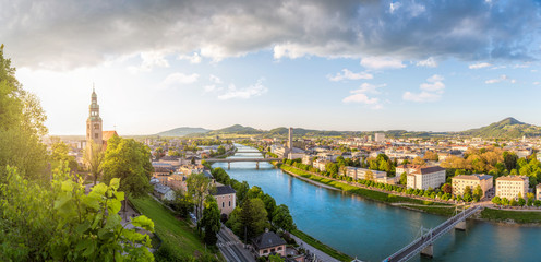 Panoramic view over Stadt Salzburg with Salzach river at evening, Salzburg, Austria Wall mural
