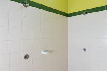 wall-mounted shower in a public locker room