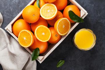 Fresh orange fruits and juice