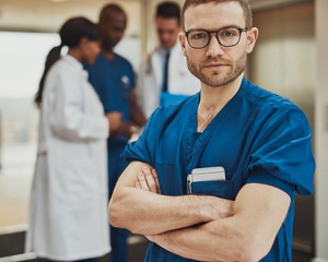 Serious surgeon in front of team