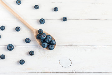 blueberry on wooden spoon top view