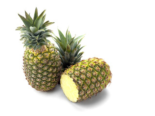 Two Pineapples on White showing one cut