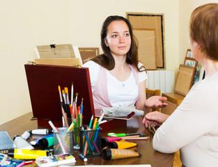 mature teacher gives advice pupil