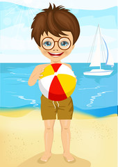 little boy with glasses playing ball on tropical beach