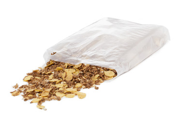 cornflakes on the box scattered on a white background