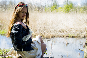 Portrait of a woman in a hoop on the head, on the river Meditation