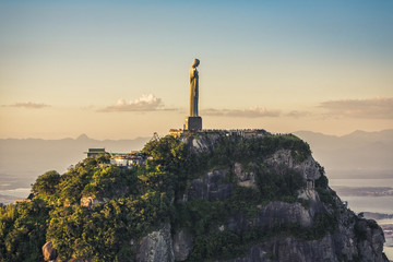 Aerial view of Christ The Redeemer Statue with people visiting Corcovado Hill.