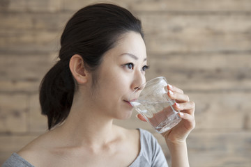 Women are drinking a glass of water