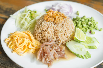 Obraz Mixed Cooked Rice with Shrimp Paste Sauce delicious Thailand's national dishes,  in Thai call  - Kao Cluk Ka Pi  - fototapety do salonu